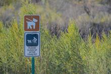 Keep Dogs On Leash, Please Clean Up After Your Pets Sign. At Topock Marsh, Lake Havasu, Arizona USA