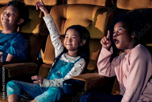 Fotografie, Obraz Three children having fun watching movie