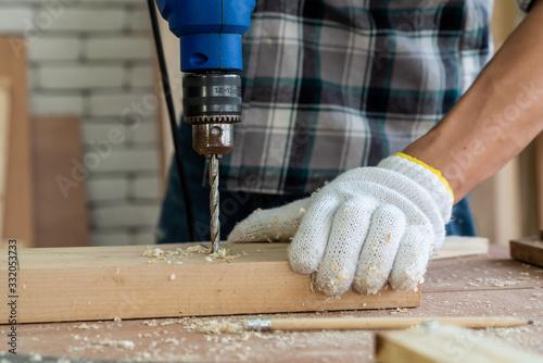 Carta da parati Carpenter working on wood craft at workshop