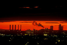 Industrial Sunset With Smokestacks Over Newark, NJ