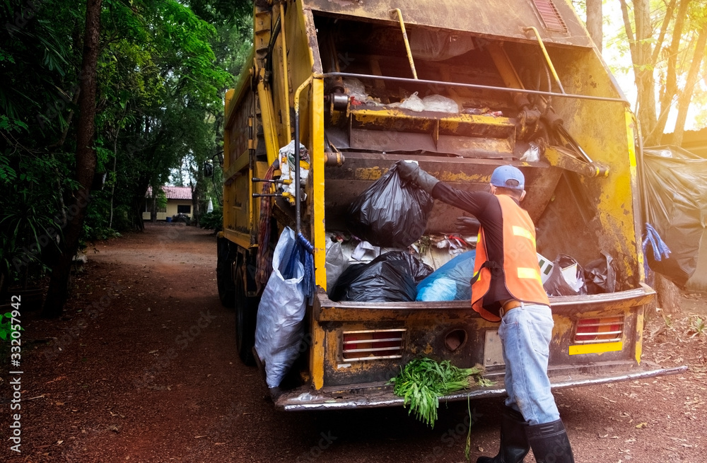 Fototapeta Workers collect garbage with Garbage collection truck