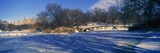 Panoramic view of bridge over frozen pond in Central Park, Manhattan, NY on upper west side near Central Park West