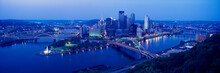 Panoramic Evening View Of Pittsburgh, PA With West End Bridge, And Allegheny, Monongahela And Ohio Rivers