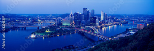 Slika na platnu Panoramic evening view of Pittsburgh, PA with West End Bridge, and Allegheny, Mo