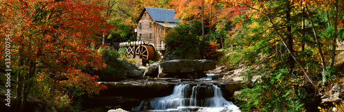 Fotografie, Tablou Panoramic of Glade Creek Grist Mil and autumn reflections and waterfall in Babco