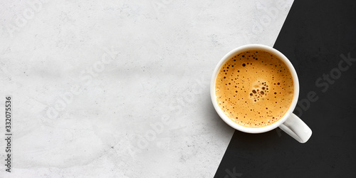 Fototapeta cup of coffee on cement table background obraz