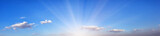 Panorama of blue sky with bright sun