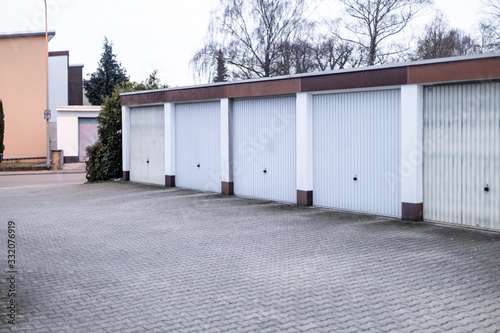 Fotografia old private garages for storage or cars in rows in Germany