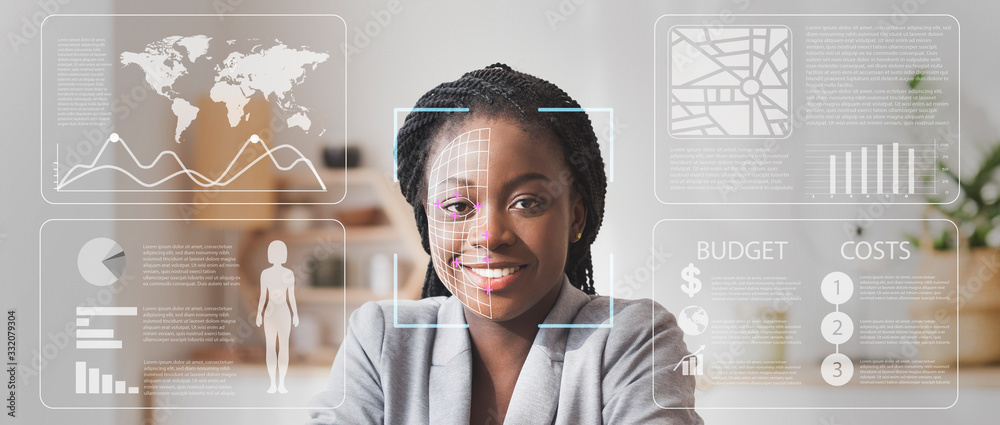 Fototapeta Face scanning of African American businesswoman in defocused office with double exposure of information on screen