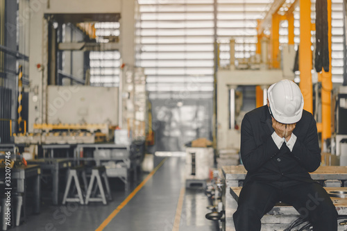 Fototapeta Entrepreneur feel Stressful depressed situation in factory.Unemployed Jobless People Crisis who Recession.Senior worker despair low economic crisis,business failure or government failed manage economy obraz