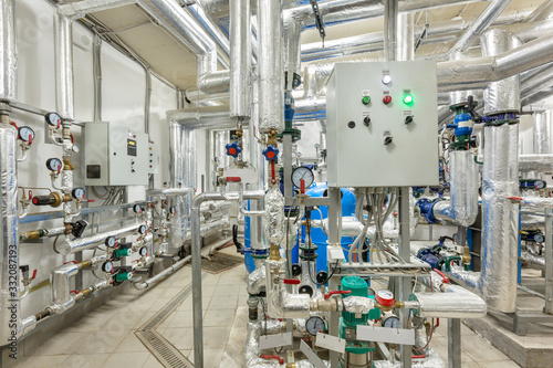 Fototapeta interior of an industrial boiler house, technological unit with many sensors, indicators and valves obraz na płótnie