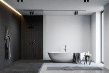 White And Black Bathroom With Tub And Shower