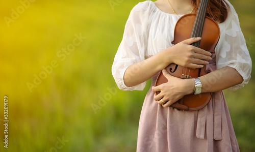 Fototapeta woman playing the violin at park