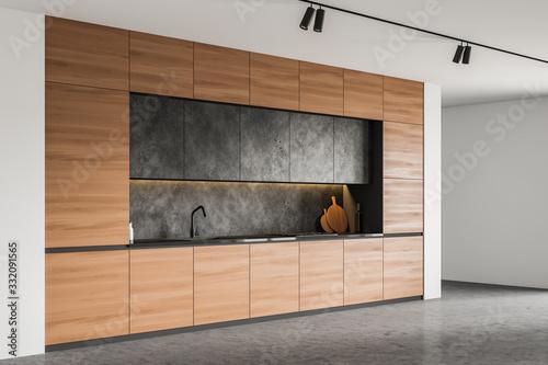 Obraz Wood countertops in spacious white kitchen corner - fototapety do salonu