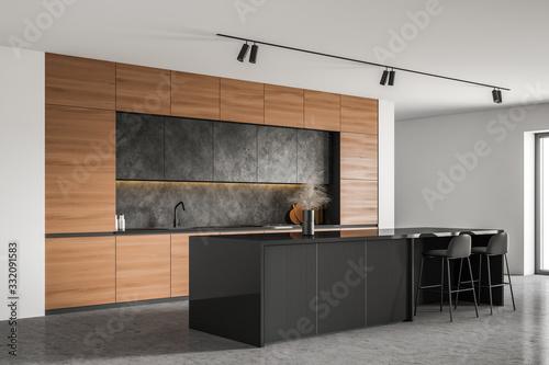 Fototapeta Bar with stools in white kitchen corner obraz