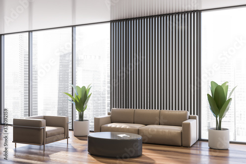 Obraz Gray office waiting room corner with sofa - fototapety do salonu