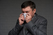 infected man sneezes or coughs and has symptoms of the disease - healthcare and medicine concept