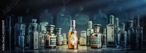 Cuadros en Lienzo A bottle of poison on a background of old medical, chemistry and pharmacy glass