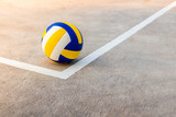 volleyball near the white line.