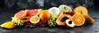 Tropical fruits background, many colorful ripe fresh tropical exotic fruits