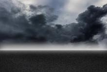 Asphalt Road And Storm Sky