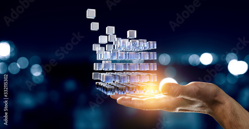 Tela Hand holding glowing cubes. Innovation and creativity concept.