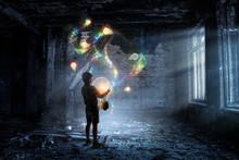 Boy Holding A Light Bulb