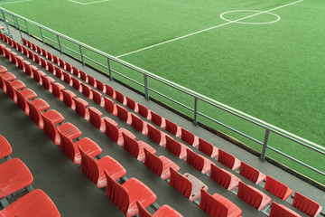 Empty rows with red seats on a football stadium