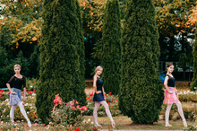 Three Modern Female Ballet Dancers Posing In Beautiful Park.
