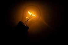 Incandescent Light Bulb On Bla...