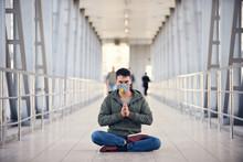 A Man Is Meditating At Empty P...