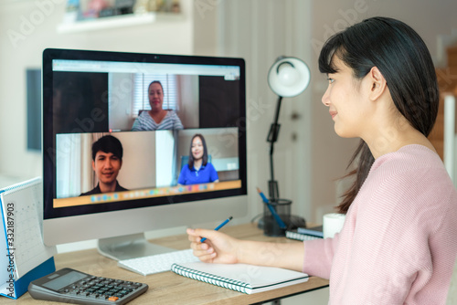 Asian business woman talking to her colleagues about plan in video conference. Multiethnic business team using computer for a online meeting in video call. Group of people smart working from home.. - 332187903
