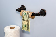 Empty Toilet Paper Roll Wrapped In 20 Dollar Bills. Concept Of Supply Shortage, Hoarding And Price Gouging Due To Coronavirus, Covid-19 Worldwide Pandemic