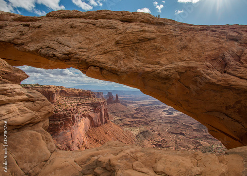 Fototapety, obrazy: Clouds in the sky above Mesa Arch in Canyonlands National Park near Moab, Utah