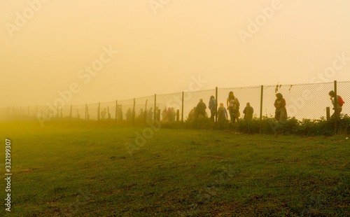 Fotografia Trabzon / Turkey - August 07 2019: Silhouette of people walk behind the wire in