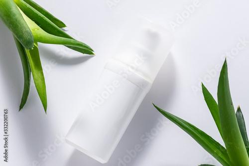 Organic moisturizing cream with Aloe Vera extract on white background close u...
