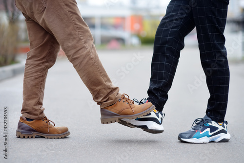 Two men greeting each other with foot instead of handshake Canvas Print
