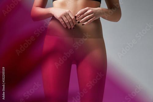 Fototapeta Part of woman body perfect shape hips legs skin tan wear stockings, nylons, pantyhose lingerie hosiery hose studio shot on white background. obraz