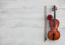 Vintage Violin On A White Wooden Background