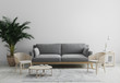 Leinwanddruck Bild - Modern interior of living room mock up in gray tones with gray sofa and wooden armchair, palm tree and coffee table, living room interior background, scandinavian style, living room mockup, 3d render