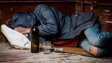A Homeless Man, A Drunk, Fell Asleep On The Street. The Concept Of Alcoholism And Homelessness