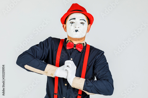 Photo Clown with red suspenders and red hat on white background