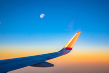 The Wing Tip Of The Plane In Early Morning Flight