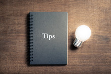 Tips Book And Light Bulb