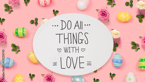 Fototapeta Do all things with love message with Easter eggs on a pink background obraz