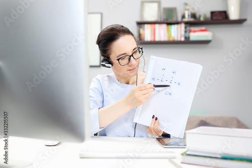 Fototapeta Online lesson.  The teacher conducts the lesson online. obraz