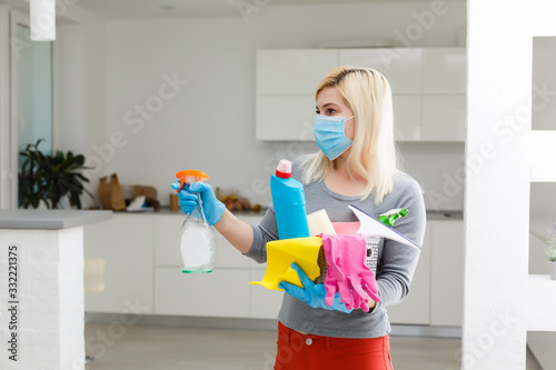 Fototapeta Coronavirus Pandemic. A disinfector in a protective mask sprays disinfectants in the room. Prevention of Coronavirus Disease. Environmental Cleaning and Disinfection with Coronavirus Epidemic obraz na płótnie
