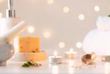 Spa set on light bokeh backdrop. Healthy lifestyle. Bathroom or spa salon interior. Wellness treatment.