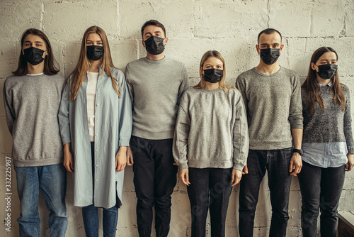 Valokuvatapetti group of young caucasian people in protective medical mask, they take care of health, afraid of coronavirus infection