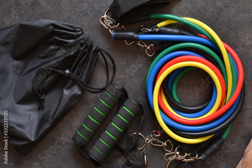 Sports accessory - expander with a carbine on a dark background.